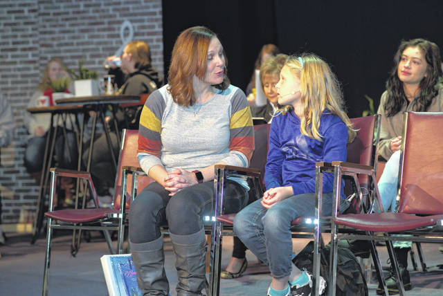 Dr. Emily Johnson with her daughter, Mirabelle. Dr. Johnson plays the lead role of Paige and Mirabelle plays the role of daughter, Violet.