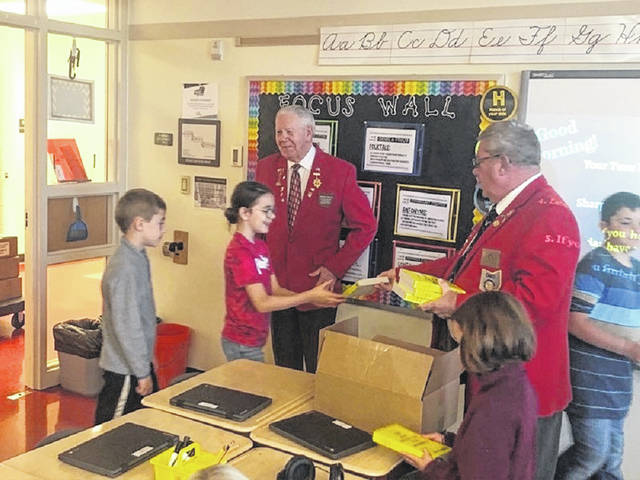 Elks Lodge #129 Dictionary Program chairman and Past President Dan Pfaff (right) and Past President and assistant to the program Ed Helt (left) greet third graders with dictionaries. So far over 11 years the Elks have helped a total of 4,896 third graders with education.