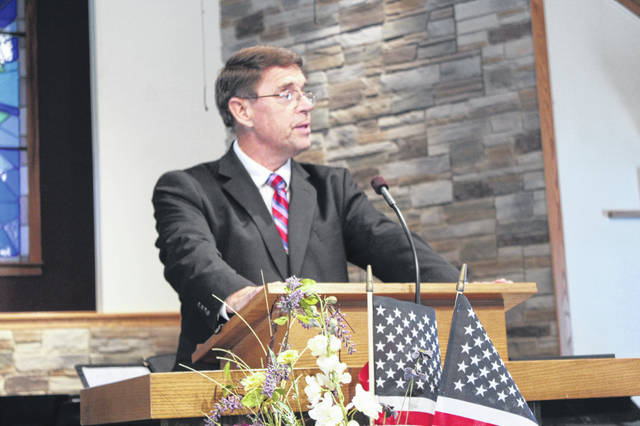 Pastor Tony Garren prayed for veterans during the annual Veterans Day program.
