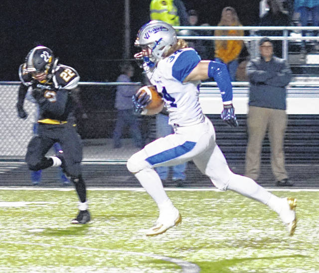Washington's Jameson McCane (34) runs for a touchdown in the first half of the Fayette County rivalry game at Miami Trace High School Friday, Nov. 1, 2019. Pictured for Miami Trace is Ashton Connell (22).