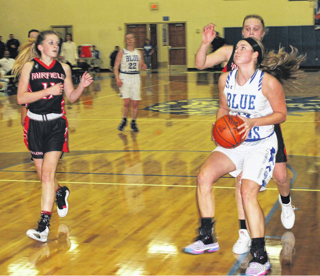 Washington senior Shawna Conger (right) drives to the basket during the season-opening game at home against Fairfield Tuesday, Nov. 26, 2019. Conger was the game's leading scorer with 24 points. Pictured at left for Fairfield is Emma Fouch (11).