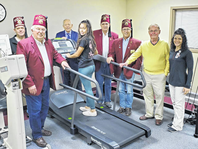 From left: Shriners Paul Marshall, Warren Craig, FCMH Foundation member Roger Kirkpatrick, patient Keely Quetchum, Shriner Bill Sowash, WCH Shrine Club President Milan Hansen, Shriner Steve Simpson and Donna Snyder, FCMH therapist.
