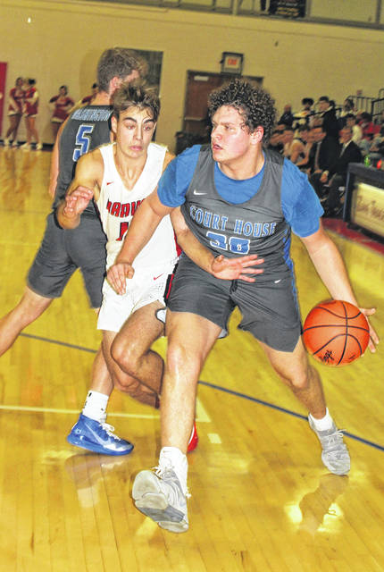 Washington's Trevor Rarick drives around a player from Logan Elm as Drew Moats sets a screen during the season-opening game at the Zane Trace Tip-Off Classic Friday, Nov. 29, 2019. Rarick was named the Blue Lions' MVP of the game.