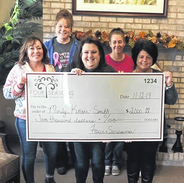 Four Seasons of Washington was able to present a $2,000 check to local breast cancer survivor Mindy Knorr-Smith following several fundraisers the community took part in. Those fundraising events included a bake sale, a senior luncheon and a chili lunch. During the facility's annual craft show earlier this month, a raffle was held with the proceeds from it going toward the assistance. Pictured are (back, L-R) Kristi Carver and Christy Bennett-Adams along with (front, L-R) Tracy Ross, Mindy Knorr-Smith and Jodi Unger.
