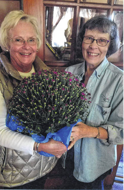 Pictured is Mary Estle (R) with Julia Hidy (L), who was elected as president of the Fayette Garden club for the next two years.