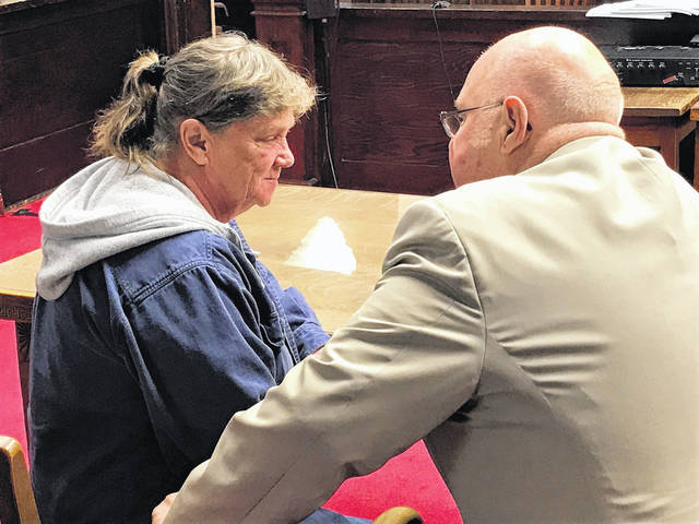 At a January pretrial, Rita Newcomb, left, confers with her defense attorney, former Portsmouth Mayor Franklin Gerlach.