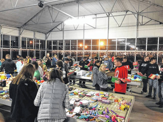 The Miami Trace FFA attended the annual Operation Christmas Child Packing Party at McClish's Plants Plus on Thursday, Nov. 14. Miami Trace FFA sponsored a two-week collection drive at Miami Trace High School and Middle School along with the Fayette Christian School and Church in order to collect toys, hygiene products, and school supplies. These items are donated for underprivileged children affected by war, poverty, natural disasters, famine, and disease; and to children living on Native American reservations in the U.S. Nearly 120 FFA members and guests came to support and help pack 672 boxes. Members also listened to a guest speaker go further into depth on how important this project is and how one box can cause a major impact on one child's life.This was the 10th year the Miami Trace FFA helped sponsor Operation Christmas Child efforts. The Miami Trace FFA looks forward to continuing this tradition and making a difference in our world in the future.