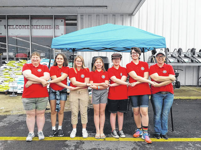 Some of Troop 7312 at their Bake Sale and Carwash Fundraiser at TSC in Washington C.H. Pictured (L to R): Committee Chair Leah Slawson, Historian Kayla George, SPL Erynn Hagerman, Den Chief Bailey Miller, Asst. SPL Cordelia Hammond, Scribe Hope George and Scoutmaster Mikki Lehr. Not Shown: Brooklynn Miller, Aaliyah Rife, and Madison and Hailey Rhoads