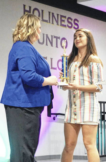 The Washington High School's volleyball program honored its own at a end-of-season banquet in November. Above, head coach Ashley DeAtley presents Aaralyne Estep with the Best Defense Award.