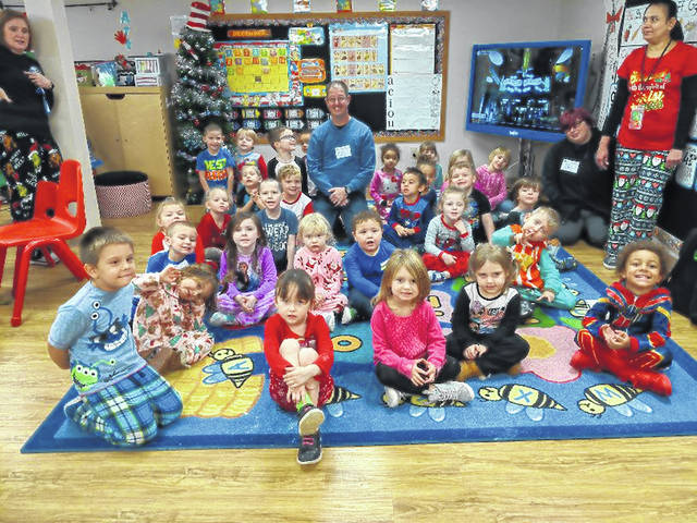 Carnegie Public Library serves Fayette County residents within and beyond the walls of the library. Librarians frequently provide outreach services throughout the community. One busy day Aaron Teter delighted children with stories and song at Head Start.