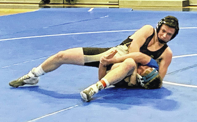 Miami Trace's Aaron Little pinning Gage Miller of Chillicothe during a Frontier Athletic Conference dual meet Wednesday, Dec. 11, 2019 at Chillicothe High School.