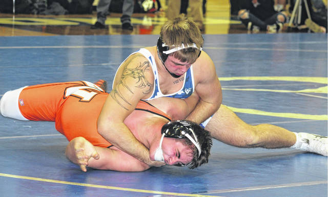 Washington's Collier Brown is about to pin his Wilmington opponent at 220 pounds during a dual meet Wednesday, Dec. 11, 2019 at Washington High School.