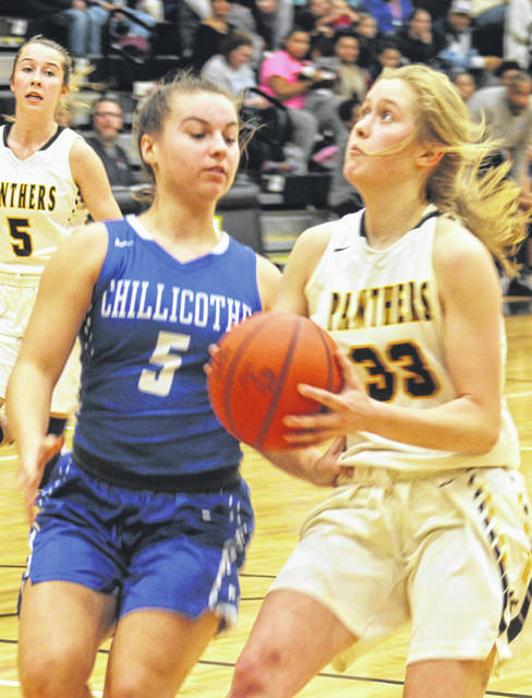 Miami Trace sophomore Emma Pitstick drives to the basket, guarded by Chillicothe's Julia Hall during a Frontier Athletic Conference game at Miami Trace High School Wednesday, Dec. 4, 2019.