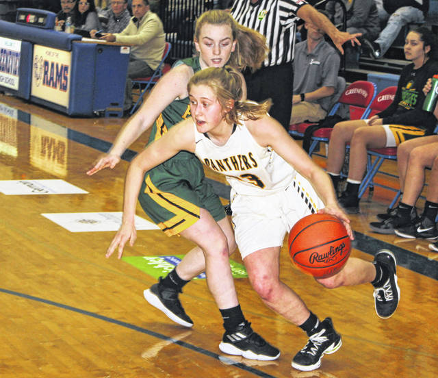 Miami Trace sophomore Emma Pitstick drives around a player from Madison Plains during a semifinal game of the McDonald's Holiday Tournament Friday, Dec. 27, 2019 at Greeneview High School.