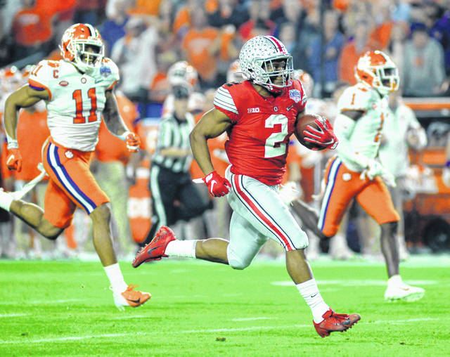 Ohio State junior J.K. Dobbins outruns the Clemson defense to score from 68 yards out in the first quarter of the Fiesta Bowl.