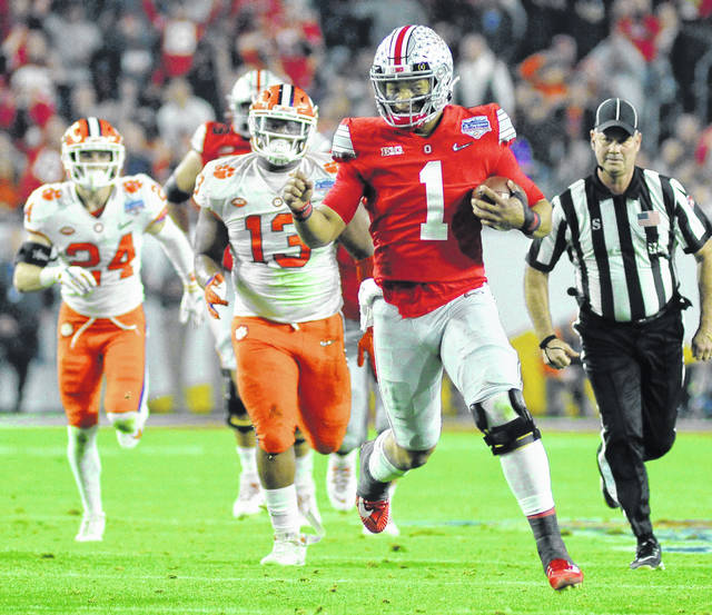 Ohio State quarterback Justin Fields breaks loose for a 21-yard gain in the second quarter of the Fiesta Bowl Saturday, Dec. 28, 2019.
