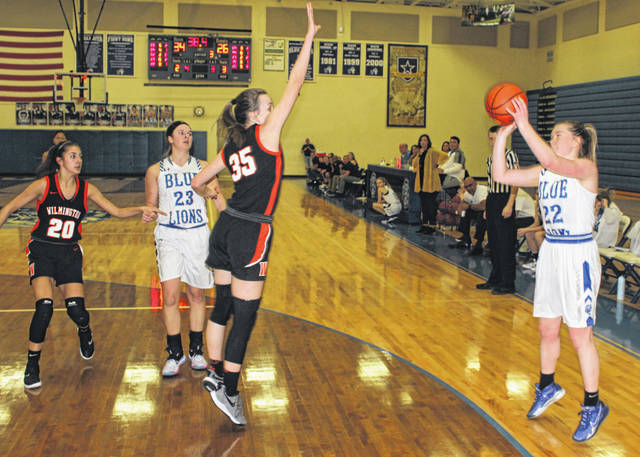 Washington senior Halli Wall (right) puts up a three-point shot over Wilmington freshman Katie Murphy during a non-conference game at Washington High School Wednesday, Dec. 18, 2019. Also pictured are seniors Sami McCord (20) of Wilmington and Shawna Conger of Washington. Wall connected on a game-high three three-point field goals in Washington's 51-46 victory over the Hurricane.