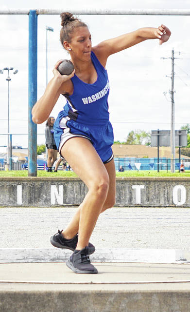 In this Record-Herald file photo from May, Washington's Hannah Haithcock competes in the shot put at the Division II District track meet Tuesday, May 14 at Washington High School. Haithcock placed third in the event to qualify to next week's Regional meet.