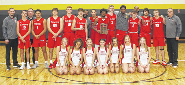 The London Red Raiders varsity basketball team on the court at Miami Trace High School after posting a 59-43 win over the Panthers in the championship game of the McDonald's Holiday Tournament Saturday, Dec. 28, 2019.