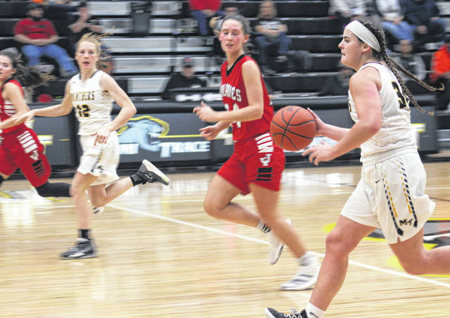 Miami Trace junior Delaney Eakins (right) brings the ball up the floor during a Frontier Athletic Conference game against Jackson Saturday, Nov. 30, 2019 at Miami Trace High School. Also pictured for the Lady Panthers is junior Magarah Bloom.