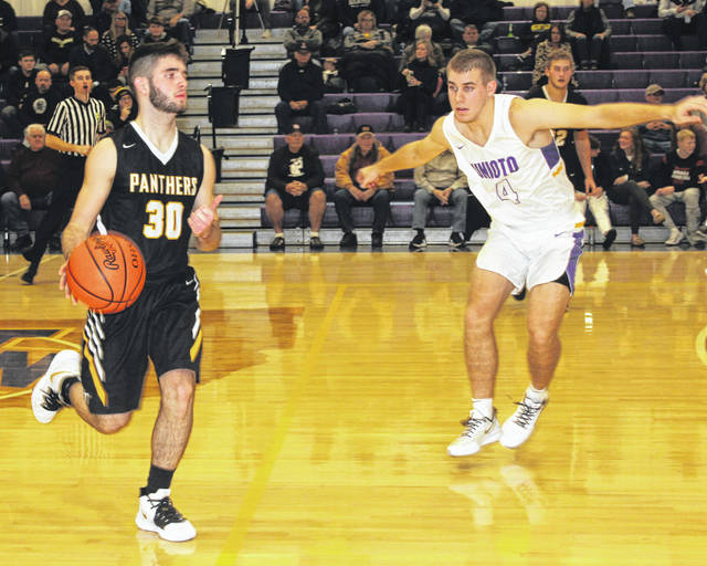 Miami Trace senior Kyler Conn (left) brings the ball up court against Unioto senior Nate Keiser during a non-conference game at Unioto High School Tuesday, Dec. 3, 2019.