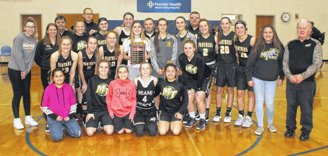 The Miami Trace Lady Panthers won the McDonald's Holiday Tournament title by beating London, 52-46 Monday, Dec. 30, 2019 at Greeneview High School in Jamestown. (front, l-r); Lawson Grooms, ball girl, Mallory Lovett, Gracie Lovett, ball girl, Hillary McCoy, Mallory Pavey; (middle, l-r); Emma Pitstick, Aubrey McCoy, Magarah Bloom, Gracee Stewart, Shaylee McDonald, Grace Bapst; (back, l-r); Piper Grooms, manager, coach Kayla Dettwiller, Karl Kellenberger, scorebook-keeper; Addy Little, coach Brian Southward, Delaney Eakins, Lilly Workman, head coach Ben Ackley; Hillery Jacobs, coach Shawn Grooms; Sidney Payton, Gracey Ferguson, Libby Aleshire, Zoe Grooms and Truman Runyon, eqiupment manager.