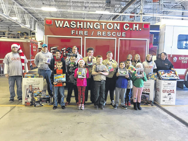"On Saturday, Boy Scouts Pack 112 and Troop 112, supported by Red Collar Pet Foods and the Washington Court House Fire Department, sponsored a Toys for Tots drive. Red Collar employees delivered three boxes full of toys and approximately four boxes full of toys were collected. ""It was a very good day, and we hope to make this an annual event,"" explained Fire Chief Tim Downing."