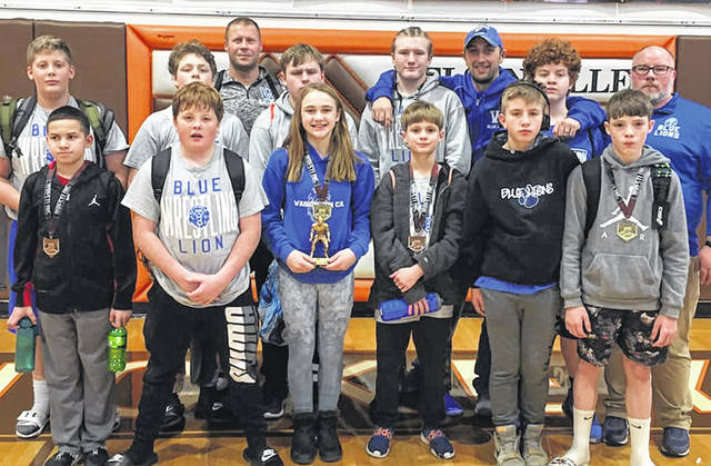 The Washington Middle School wrestling team and coaches at the Nelsonville-York tournament on Dec. 21, 2019.