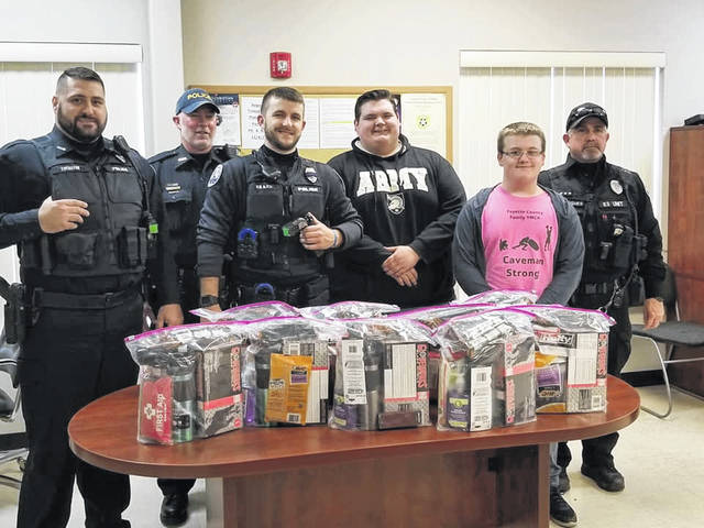 Two high school students, Wes Pickering and Chris Schick, recently gifted the Washington Court House Police Department with 10 gift bags that contained various items that may be useful in the officers' profession. Those items included tourniquets, first aid kits, latex gloves, pens, hand wipes, hand sanitizer, knives, gift cards, cough drops and coffee mugs. Recently through Facebook, the department thanked the students as well as all those who have brought them food during the Christmas season. Pictured (L-R) are Ptl. Everhart, Sgt. Shoopman, Ptl. Ellis, Pickering, Schick and Ptl. Hughes.