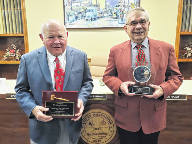 Council member Jim Chrisman (L) received an award as his second term as chairperson comes to an end, while council member (R) Steve Jennings received an award as his final term on council comes to an end.