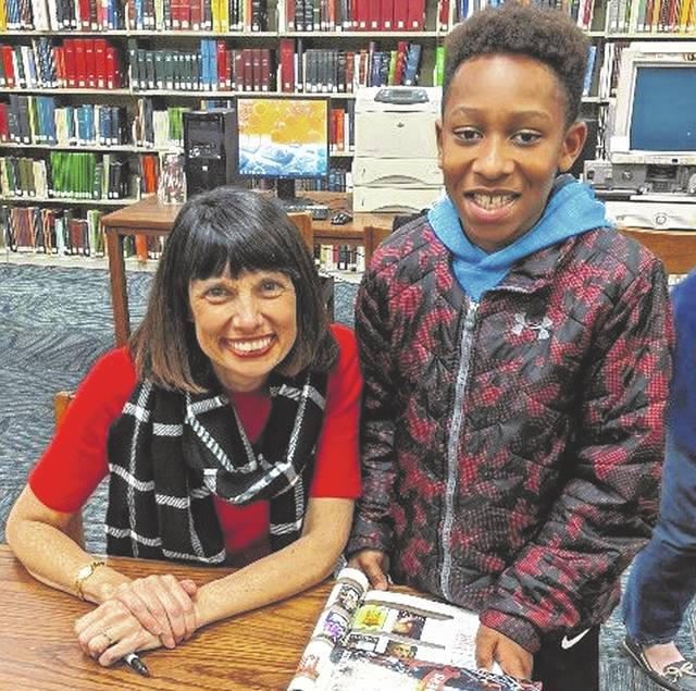 Author Margaret Peterson Haddix visited Carnegie Library on Thursday. Andrew was happy to meet the author of the book he is reading in school. Library staff is certain this photo deserves extra credit on his book report.