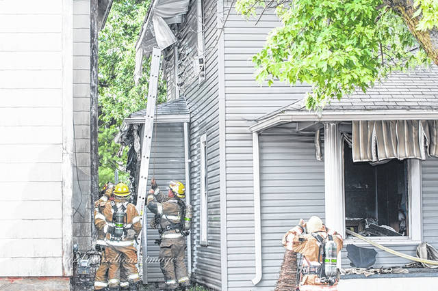In this Record-Herald file photo from Aug. 23, firefighters and police responded to a house fire on Temple Street. Although no injuries were reported, flames did cause damage to a neighboring home through windows that busted out during the fire.