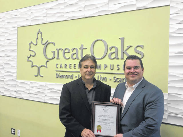 Great Oaks Treasurer/CFO Ben Vanhorn with Ryan Holiday, the Auditor's regional liaison, who presented the award.
