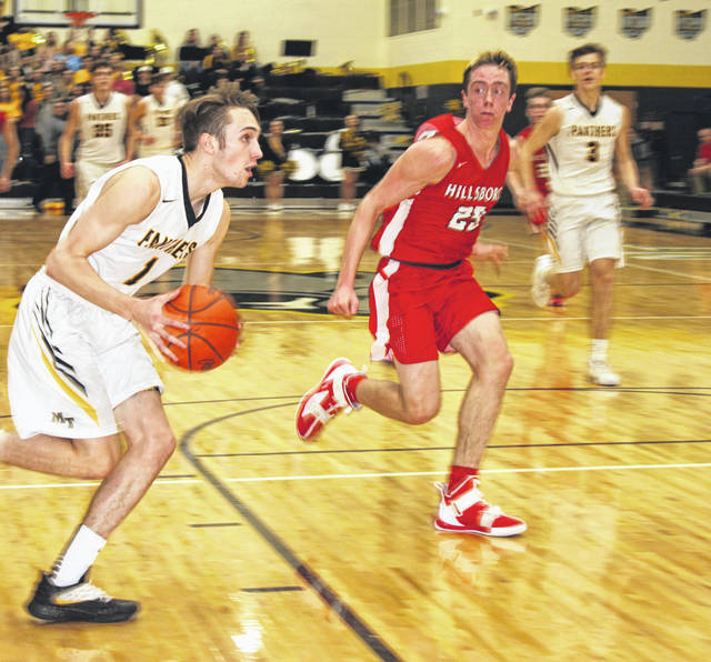 Miami Trace junior Cameron Moore drives toward the basket during Friday night's game against the Hillsboro Indians.