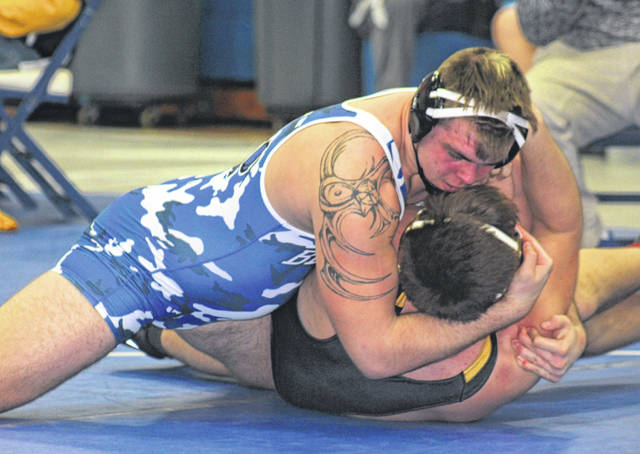 Washington senior Collier Brown looks to pin his opponent in a match at 220 pounds Saturday, Jan. 25, 2020 in the Blue Lions' bracket tournament. Brown won the 220-pound weight class.