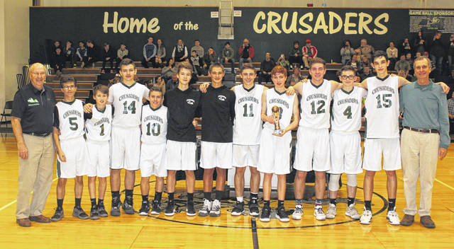 """The Crusaders on the court at Fayette Christian School after winning the McDonald's Invitational Saturday, Jan. 25, 2020. (l-r); FCS head coach Gary Shaffer, Toby Butcher, Jake """"J.P."""" Crichton, Justin Wines, Gage McDaniel, Nate Crichton, Brady Bumpus, Nicholas Epifano, Christopher Toill, Lane Hufford, Zander Ivey, Drew Pontius and FCS assistant coach Vic Pontius."""