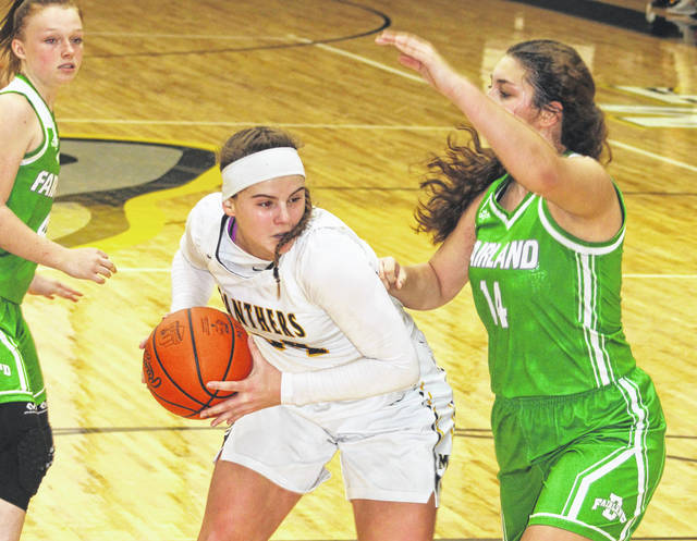 Miami Trace junior Delaney Eakins (left) takes the ball to the basket while defended by Fairland sophomore Jessica King in a non-conference game at Miami Trace High School Saturday, Jan. 4, 2020.