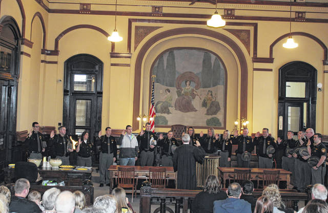 From left to right the following Fayette County Sheriff's Office personnel were sworn in Friday in Fayette County Common Pleas Court by Judge David Bender: Detective Treg Brown (Assignment to Detective); Andrew Park (Promoted to Patrol Sergeant); Tonya Browning (Promoted to Corrections Corporal); Trevor Mustain (Corrections Deputy - Recent Hire); Kyle Lower (Corrections Deputy - Recent Hire); Dirk Witherspoon (Promoted to Patrol Sergeant); Sara Hempstead (Promoted to Patrol Sergeant); Nikki Miller (Promoted to Corporal - Administrative Services); Valerie Taylor (Promoted to Corporal - Communications / 9-1-1 Coordinator); Jodi Kelley (Promoted to Lieutenant - Administrative Services); Adam Greenlee (Promoted to Corrections Corporal); Matt Weidman (Promoted to Lieutenant - Corrections); Kodi Jackson (Promoted to Corrections Corporal); Jordan Baker (Corrections Deputy - Recent Hire); Joshua Cash (Promoted to Corrections Corporal); and Samuel Curl (Corrections Deputy - Recent Hire).