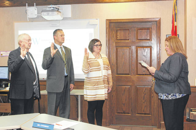 Washington Court House City Schools Treasurer Becky Mullins administered the Oath of Office to board members Dennis Garrison, Craig Copas and Jennifer Lynch Thursday evening at the WCHCS District Office.