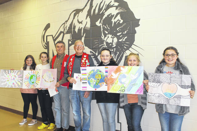 New Holland Lions Club President Marty Mace and Jeffersonville Lions Club member Gary Herdman visited Miami Trace Middle School to congratulate the six winners of the 2019 Peace Poster Contest. Pictured (L to R): New Holland second place winner Aubrey Pfeifer, New Holland first place winner Lauren Farrens, Mace, Herdman, Jeffersonville first place winner Rylee Blair, Jeffersonville second place Abigail Noble and Jeffersonville third place Ella McCarty. Not pictured is New Holland third place winner Ellison Darif.