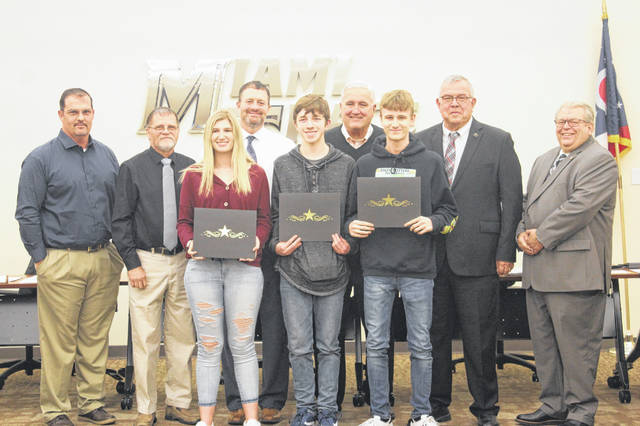 The Miami Trace Local Schools Board of Education honored several students as part of its Panther Spotlight Monday evening at the district office. Samantha Sever, Austin Musser and Gary Golden were celebrated for their dedication to the Miami Trace High School Video Production Department by the board and were treated to dinner for their accomplishments.