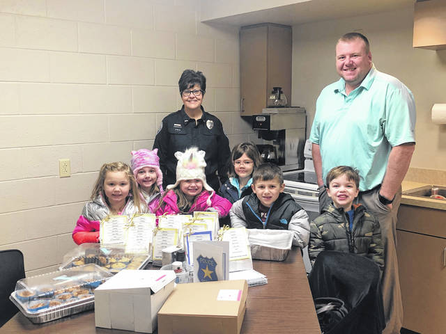 Grace United Methodist Preschool and childcare students provided baked goods for local law enforcement and thanked everyone for keeping them safe in the community in recognition of National Law Enforcement Day. Pictured are Washington Police Department dispatcher Traci Bennett and detective Colt Sever.