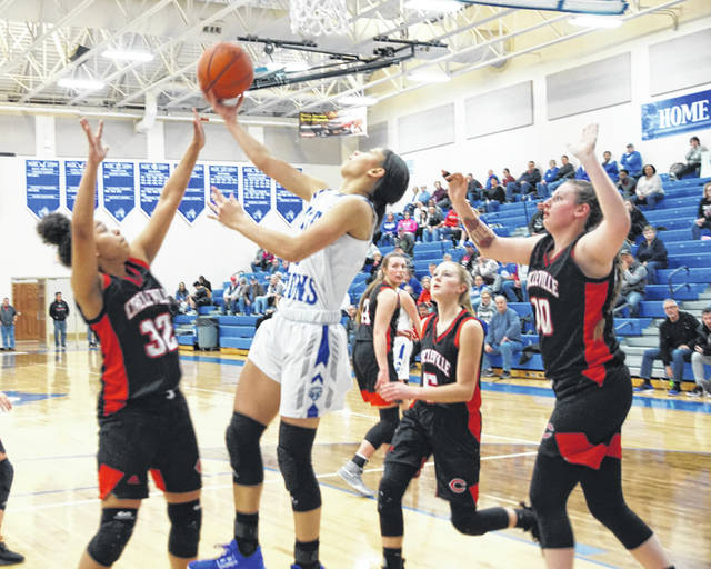 Washington sophomore Jeleeya Tyree-Smith executes a reverse lay-up during a non-conference game against Circleville Wednesday, Jan. 22, 2020 at Washington High School. Among the players pictured for Circleville are (l-r); Jaylah Captain (32), Tori Bircher (5) and Meghan Davis (10).
