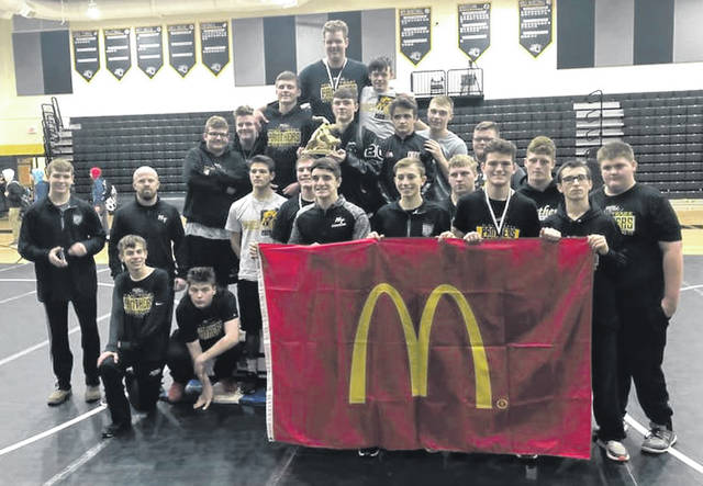The Miami Trace wrestling team is pictured on the floor at Miami Trace High School after winning the Miami Trace/McDonald's Invitational Saturday, Jan. 25, 2020. (front, l-r); Titus Lehr, Stephen Lehr, Mcale Callahan, Weston Melvin, Dawson Wallace, Aiden Johnson; (second row, l-r); Graham Carson, assistant coach Jake Garringer, Jared Seymour, Bryce Bennett, David Tyndall, Jayden LeBeau, Kyle Bennett; (back, l-r); Zane Brown, Kylan Knapp, Grant DeBruin, Storm Duffy, Alex McCarty, Vinny Munro, Treven Shoemaker and Weston Pettit. A report on the tournament ran in the Jan. 29 edition of the Record-Herald.