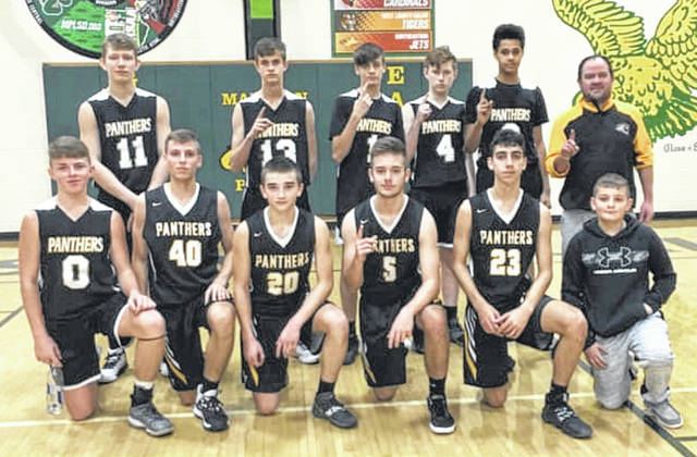 The Miami Trace Panthers j-v basketball team at Madison Plains High School after winning the McDonald's Holiday Tournament Monday, Dec. 30, 2019. (front, l-r); Wesley May, Bo Little, Isaiah Reisinger, Hayden Hunter, Cyrus Keplinger, Blake Boedecker, ball boy; (back, l-r); Anthony Groves, Braeden Morris, Jadon Rowe, Gannon Phillips, Dana Oare and head coach Jeff Smallwood.