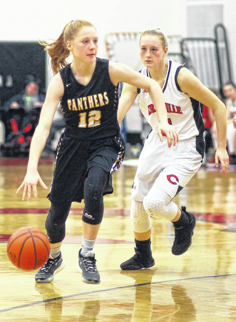 Miami Trace junior Magarah Bloom (12) is pursued by a player from Circleville during a non-conference game at Circleville High School Tuesday, Jan. 7, 2020.