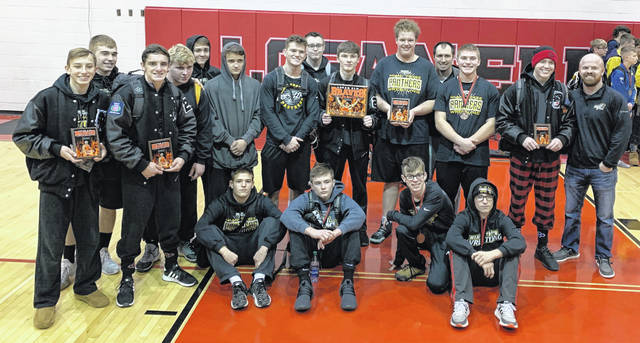 The Miami Trace wrestling team after winning the Logan Elm Invitational Saturday, Jan. 4, 2020. (l-r); Weston Melvin, Treven Shoemaker, Mcale Callahan, David Tyndall, Keegan Williams, Vincent Munro, Dawson Wallace, Zac Tinkler, Storm Duffy, Grant DeBruin, head coach Ben Fondale, Bryce Bennett, Graham Carson and coach Jake Garringer.