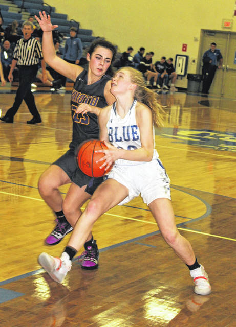 Washington freshman Natalie Woods drives to the basket while guarded by Unioto senior Alexis Miller during a non-conference game at Washington High School Saturday, Jan. 4, 2020. Woods scored a career-high 15 points as Washington fell, 53-51.
