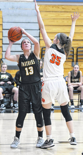 Miami Trace sophomore Libby Aleshire (13) looks to the basket during a non-conference game at Wilmington High School Tuesday, Jan. 21, 2020.