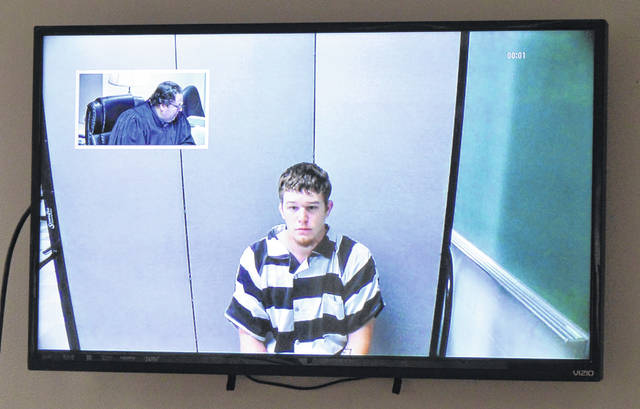 Brandon Breezley, center of screen, appears by interactive video Friday morning from the Clinton County Jail for his initial hearing in Clinton County Municipal Court. Municipal Judge Mike Daugherty can be seen in the small video inset on the upper left of the screen.
